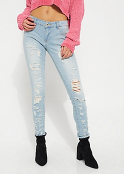 Light Wash Shredded Skinny Jean in Regular