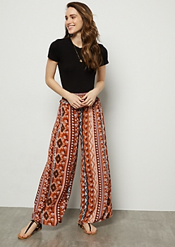 Burnt Orange Border Print Smocked High Waisted Palazzo Pants
