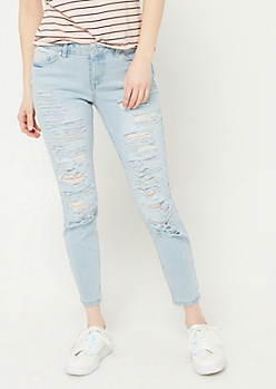 Light Wash Mid Rise Destructed Cropped Skinny Jeans in Regular