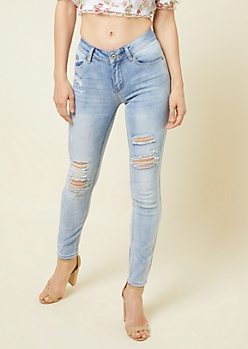 Light Wash Distressed Mid Rise Jeggings in Short