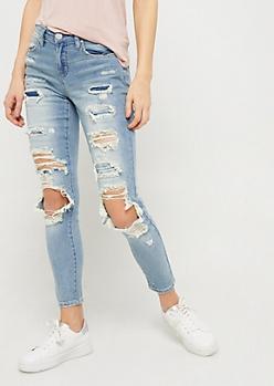 Vintage Wash Mid Rise Destroyed Skinny Jeans
