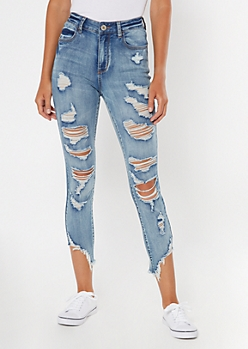 Medium Wash High Waisted Ripped Slant Hem Jeggings
