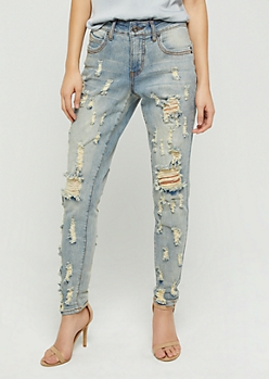 Light Wash Distressed Skinny Jeans in Curvy