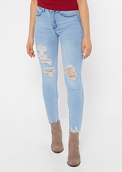 Light Wash Blown Knee Raw Skinny Jeans