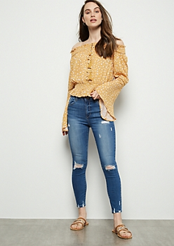 Medium Wash Distressed Mid Rise Skinny Booty Jeans