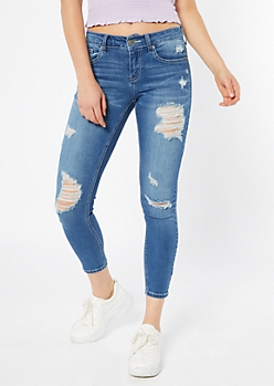 Medium Wash Distressed Mid Rise Jeggings