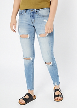 Light Wash Distressed Sandblasted Skinny Jeans