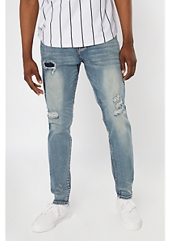 Supreme Flex Medium Wash Rip and Repair Relaxed Taper Jeans