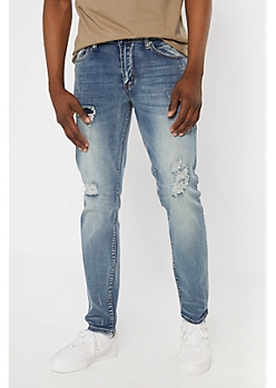 Supreme Flex Medium Wash Rip and Repair Slim Jeans