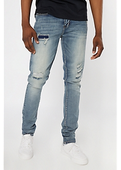 Supreme Flex Medium Wash Rip and Repair Stacked Skinny Jeans