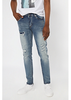 Supreme Flex Medium Wash Rip and Repair Slim Taper Jeans