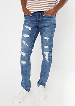 Medium Wash Ripped And Repaired Slim Taper Jeans