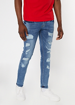 Medium Wash Ripped And Stitched Repaired Skinny Jeans