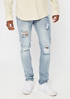 Medium Vintage Wash Blown Knee Skinny Jeans