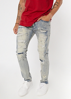 Light Faded Wash Ripped And Repaired Skinny Jeans
