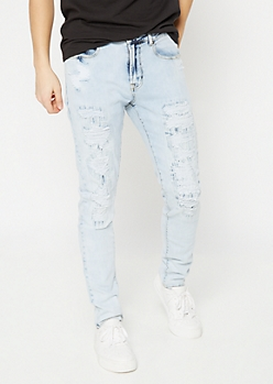 Supreme Flex Light Wash Rip and Repair Skinny Jeans