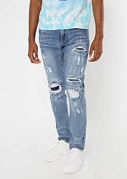 Supreme Flex Medium Wash Ripped And Repaired Skinny Jeans