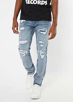 Medium Wash Ripped And Repaired Skinny Jeans