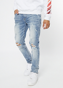 Supreme Flex Light Wash Blown Knee Skinny Jeans