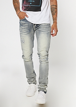 Light Tinted Wash Ripped And Repaired Stack Skinny Jeans