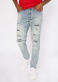 Light Wash Ripped And Repaired Mix Pattern Skinny Jeans