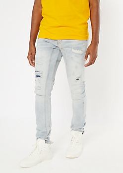 Light Wash Ripped Repaired Arc Skinny Jeans