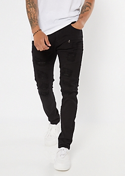 Black Ripped And Repaired Skinny Jeans