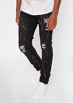 Black Paint Splattered Rip And Repair Stacked Skinny Jeans