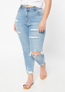 Plus Medium Wash High Waisted Ripped Hem Jeggings