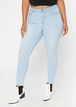 Plus Light Wash Mid Rise Ripped Jeggings